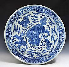 A LARGE CHINESE BLUE AND WHITE PORCELAIN CHARGER with dragons and flaming pearls, Qianlong mark, 19t