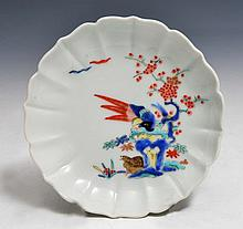 A SMALL JAPANESE KAKIEMON PETAL MOULDED SAUCER FORM DISH, decorated pheasants and quails on and besi