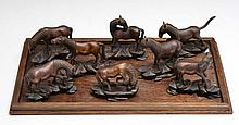 A COLLECTION OF CHINESE BRONZE MODEL HORSES, each with hardwood stands