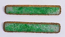 A PAIR OF CHINESE GILT BAR BROOCHES with filigree decoration and carved jade setting, 8.5cm