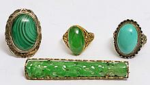 A CHINESE GILT BAR BROOCH with carved jade setting, a Chinese 14k gold ring with oval jade setting,