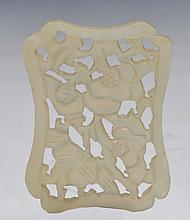 A CHINESE CARVED JADE PENDANT with fruit and flower decoration, circa 1900, 5cm long