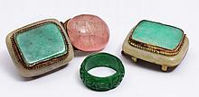 A CHINESE SPINACH JADE CARVED RING and a Chinese jade mounted buckle, late 19th Century (2)