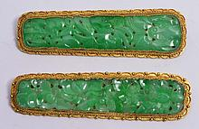 A PAIR OF CHINESE GILT BAR BROOCHES of rectangular form with pierced settings and carved jade settin