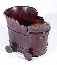 A CHINESE CHILD'S SEAT of oval form with lacquered decoration, with original wheels, 60cm long