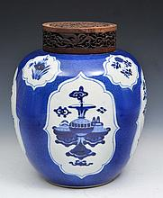 A CHINESE BLUE AND WHITE PORCELAIN OVOID JAR of powder blue ground with panels of flowers and vases,