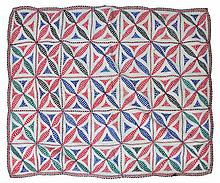 A CANTHA TEXTILE CLOTH, probably Indian, with geometric square patterns in blue, red, green and blac