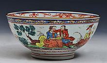 A CHINESE PORCELAIN BOWL made for the Dutch market, painted in iron red and aubergine enamels showin