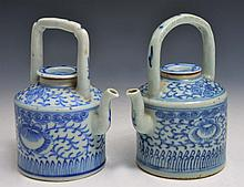 A PAIR OF CHINESE PORCELAIN BLUE AND WHITE TEAPOTS with allover scrolling foliate decoration, 19th C