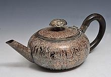 A PERSIAN SILVER METAL ON COPPER ENGRAVED TEAPOT with panels of figures and horn handle, circa 1900,