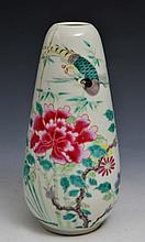 A CHINESE FAMILLE ROSE BULLET-SHAPED VASE decorated with chrysanthemums and birds, 19th Century, 20c