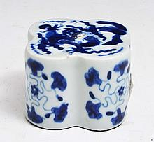 A CHINESE BLUE AND WHITE PORCELAIN SEAL decorated four claw dragon and stylised clouds, side with st