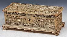 A CHINESE CANTON CARVED IVORY RECTANGULAR BOX and cover, temple scenes with figures within a foliate