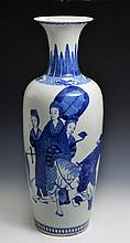 A CHINESE PORCELAIN TALL BLUE AND WHITE VASE, courtier on horseback with attendant figures having a