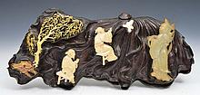 A CHINESE CARVED WOOD CLOISONNE PANEL of leaf form with ivory and jadeite figures