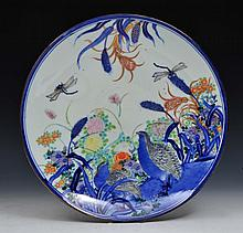 A JAPANESE FUKAGAWA CHARGER with underglaze blue decoration of quails, dragonflies and chrysanthemums with po