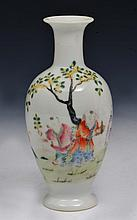 A CHINESE SMALL WHITE GROUND PORCELAIN BALUSTER VASE, figures in a garden, Republic period, 14cm