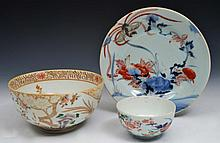 TWO JAPANESE ARITA BOWLS, the larger decorated with insects, flowers and birds, the smaller decorate