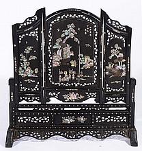 A CHINESE HARDWOOD AND MOTHER OF PEARL INLAID THREE PANEL TABLE SCREEN, temple and ceremonial figure
