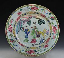 A CHINESE CHARGER, a stag mother and child in a rocky landscape with famille rose border, 18th Centu