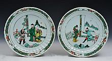 A PAIR OF CHINESE FAMILLE VERTE SHALLOW DISHES, the central terraces with various Immortals and figu