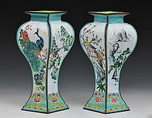 A PAIR OF CHINESE CANTON FOUR SIDED BALUSTER VASES, the panels alternating with lake, landscape, pea
