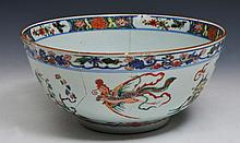 A CHINESE POLYCHROME CIRCULAR BOWL decorated with phoenix and temple dogs in a garden setting, 18th