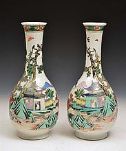 A PAIR OF CHINESE FAMILLE VERTE BOTTLE VASES, each with lake, landscape and terrace scenes, Kangxi m
