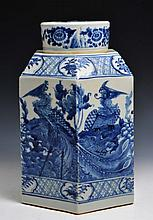 A CHINESE BLUE AND WHITE PORCELAIN HEXAGONAL CANISTER and cover, boldly painted with phoenix and peo