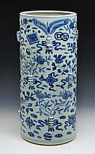 A CHINESE BLUE AND WHITE PORCELAIN STICK STAND with allover Chinese symbols and with raised gourd an