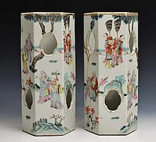 A PAIR OF CHINESE FAMILLE ROSE HEXAGONAL HAT STAND VASES decorated with various figures in a landsca