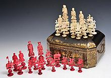 A CHINESE CANTON IVORY AND STAINED IVORY CHESS SET in a Chinese export box