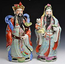 A PAIR OF CHINESE POLYCHROME PORCELAIN MODELS OF WU TI with a courtier watching Fu-ling , one holding a ruyi sceptre, 20th Century
