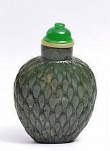 A CHINESE DARK GREEN JADE OVIFORM SNUFF BOTTLE carved with an allover rice grain pattern, green glas