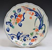 A JAPANESE IMARI SHALLOW DISH, decorated with sprays of camellia and iris flowers