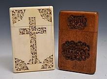 A CHINESE IVORY CARD CASE carved with an intricate town scene within a cross and four floral triangl