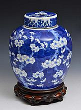 A CHINESE BLUE AND WHITE PORCELAIN OVOID GINGER JAR and cover decorated with prunus, Kangxi (1662-17
