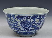 A CHINESE BLUE AND WHITE LOTUS BOWL painted with repeating lotus flower heads, Kangxi six character