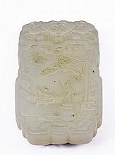 A CHINESE WHITE JADE AMULET of rectangular form carved Immortal and child in garden scene, reverse w