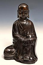 A CHINESE BRONZE SEATED MODEL OF LOHAN, 17th/18th Century, 18cm high