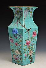 A CHINESE TURQUOISE GROUND SQUARE VASE decorated with magpies, wisteria and chrysanthemum, Qianlong