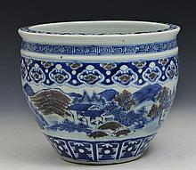A CHINESE PORCELAIN BLUE AND WHITE FISH BOWL with ruyi decoration showing building amongst mountains