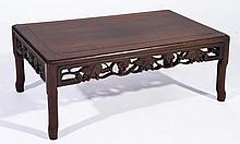 A CHINESE HARDWOOD KANG TABLE with carved fruit frieze, 75cm x 39.5cm