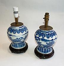 A PAIR OF CHINESE BLUE AND WHITE BALUSTER VASES decorated with landscape scenes, both with hardwood