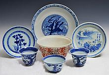 A CHINESE NANKING TEA BOWL and saucer, two other Chinese blue and white porcelain tea bowls, a sauce