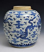 A CHINESE BLUE AND WHITE OVOID DRAGON AND PHOENIX GINGER JAR, depicting two dragons chasing a flamin