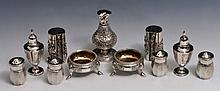 A COLLECTION OF CHINESE SILVER CONDIMENTS including pepper pots and others