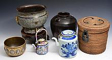 A CHINESE BLUE AND WHITE PORCELAIN TEAPOT in a wicker basket, an Indian brass and silver metal circu