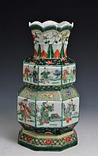 A CHINESE FAMILLE VERTE ARCHAIC STYLE OCTAGONAL VASE with panels of figures, Kangxi mark, late 19th
