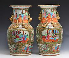 A PAIR OF CHINESE CANTON PORCELAIN VASES with panels of figures and with gilt serpent and dog of fo